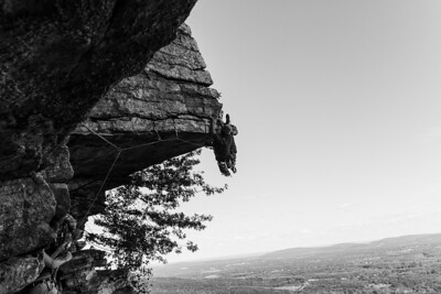 "A climber pulls on the key move of ""The Dangler"" at the Gunks in New Paltz, NY."